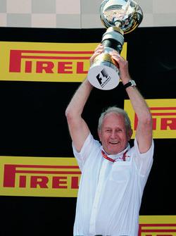 Dr Helmut Marko, Red Bull Motorsport Consultant celebrates on the podium