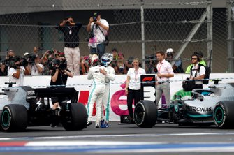 Valtteri Bottas, Mercedes AMG F1, 3rd position, and Lewis Hamilton, Mercedes AMG F1, 1st position, congratulate each other in Parc Ferme