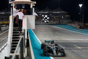 Lewis Hamilton, Mercedes AMG F1 W10, takes the chequered flag