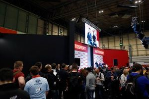 A crowd watches as presenter Alan Hyde interviews Martin Plowman and Kelvin Fletcher on the Autosport stage