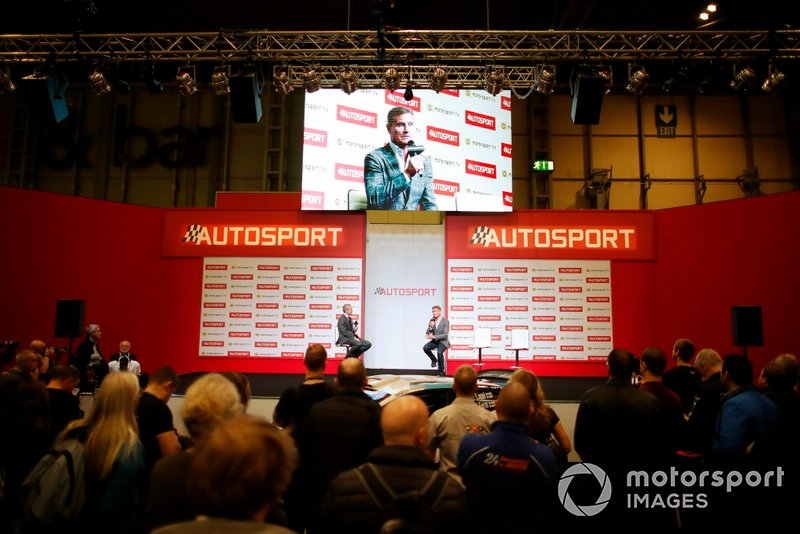 Fans watch as Stuart Codling talks to David Coulthard on the Autosport Stage
