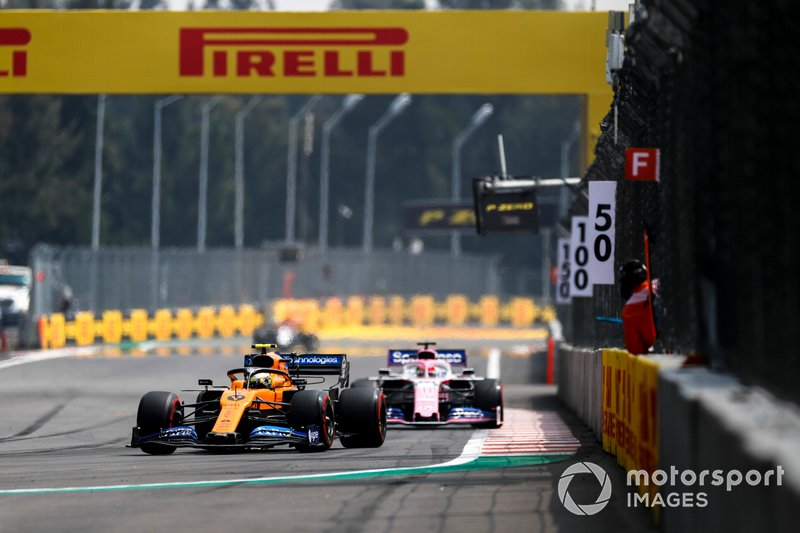 Lando Norris, McLaren MCL34, leads Sergio Perez, Racing Point RP19