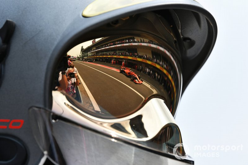 Charles Leclerc, Ferrari SF90, reflected in a fire marshals visor