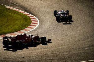 Lance Stroll, Racing Point RP19, leads Sebastian Vettel, Ferrari SF90