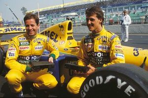 Martin Brundle and Michael Schumacher pose by their Benetton B191B