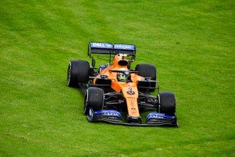 Lando Norris, McLaren MCL34 runs over the grass