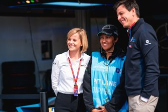 Susie Wolff, Team Principal, Venturi, husband Toto Wolff, Team Principal of Mercedes AMG F1 Team take a photo with a pit lane marshal