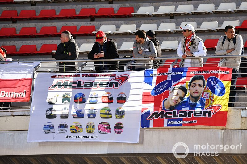 Fans display banners in support of Carlos Sainz Jr., McLaren, and Lando Norris, McLaren