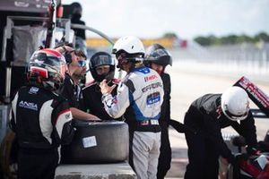 #2 ANSA Motorsports team members with IMSA official member