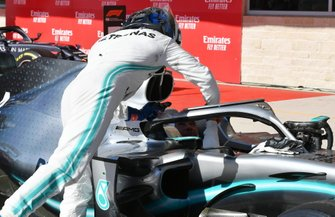Valtteri Bottas, Mercedes AMG F1, 1st position, congratulates Lewis Hamilton, Mercedes AMG F1, 2nd position, as he arrives in Parc Ferme