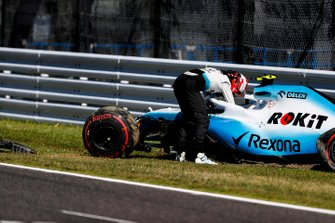 Robert Kubica, Williams Racing, climbs out of his car after crashing in Q1
