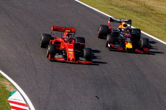 Charles Leclerc, Ferrari SF90, battles with Max Verstappen, Red Bull Racing RB15, on the opening lap