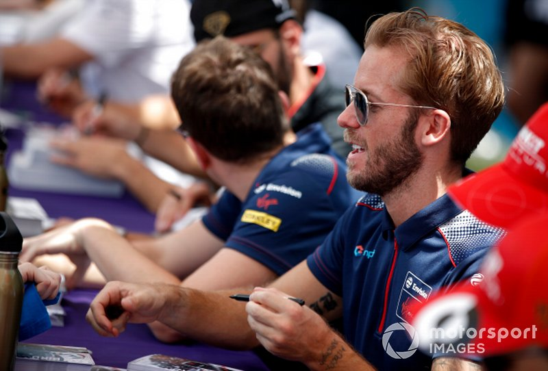 Sam Bird, Virgin Racing signs autographs for fans