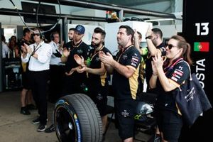 The Techeetah team celebrate in the garage