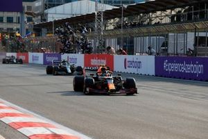 Sergio Perez, Red Bull Racing RB16B, 1st position, Sebastian Vettel, Aston Martin, 2nd position, and Pierre Gasly, AlphaTauri, 3rd position, cross the line