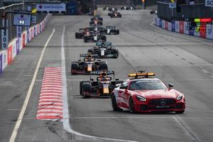 The Safety Car Max Verstappen, Red Bull Racing RB16B, Sergio Perez, Red Bull Racing RB16B, Lewis Hamilton, Mercedes W12, and the rest of the field