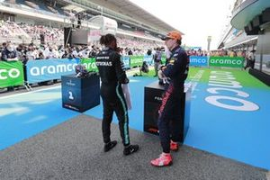 Lewis Hamilton, Mercedes, 1st position, and Max Verstappen, Red Bull Racing, 2nd position, talk in Parc Ferme