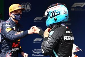 Pole man Valtteri Bottas, Mercedes, celebrates in Parc Ferme with Max Verstappen, Red Bull Racing