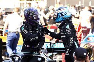 Valtteri Bottas, Mercedes, congratulates Lewis Hamilton, Mercedes, on securing his 100th F1 pole in Parc Ferme