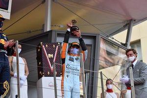 Lando Norris, McLaren, 3rd position, receives his trophy