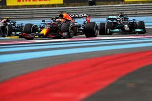 Max Verstappen, Red Bull Racing RB16B, leads Sir Lewis Hamilton, Mercedes W12