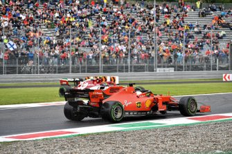 Sebastian Vettel, Ferrari SF90, passes Antonio Giovinazzi, Alfa Romeo Racing C38, who has spun