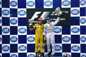 Podium: Race winner Kimi Raikkönen, McLarenn, Giancarlo Fisichella, Jordan