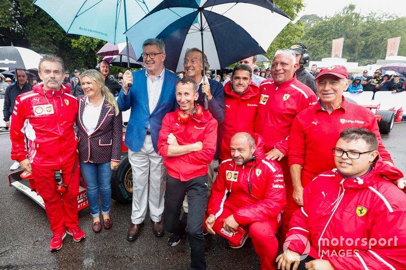 Corinna Schumacher, Ross Brawn, Luca Cordero di Montezemolo with Ferrari Mechanics before the Michael Schumacher Celebration