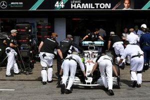 Lewis Hamilton, Mercedes AMG F1 W10, is returned to the garage during Qualifying