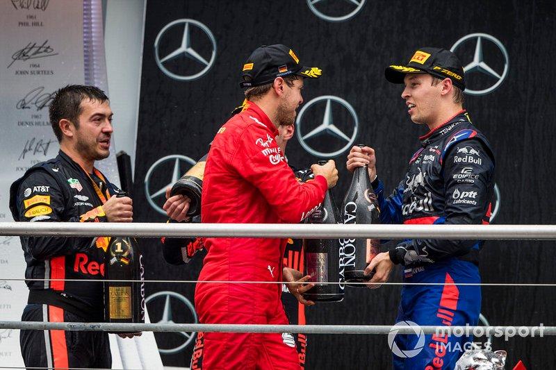 Guillaume Rocquelin, Head of Race Engineering, Red Bull Racing, Sebastian Vettel, Ferrari, 2nd position, and Daniil Kvyat, Toro Rosso, 3rd position, on the podium