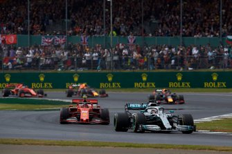 Lewis Hamilton, Mercedes AMG F1 W10, leads Charles Leclerc, Ferrari SF90, Max Verstappen, Red Bull Racing RB15, Pierre Gasly, Red Bull Racing RB15, and Sebastian Vettel, Ferrari SF90