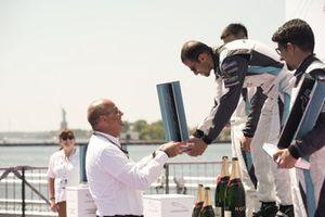 Bandar Alesayi, Saudi Racing receives the winner's trophy on the podium