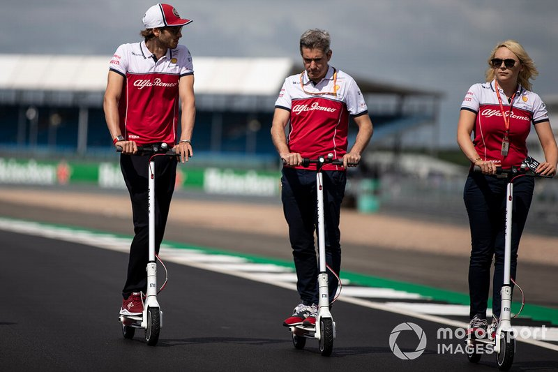 Antonio Giovinazzi, Alfa Romeo Racing walks the track on a scooter