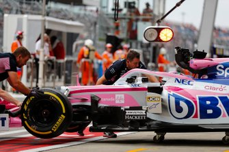 Sergio Perez, Racing Point, is pushed into his garage