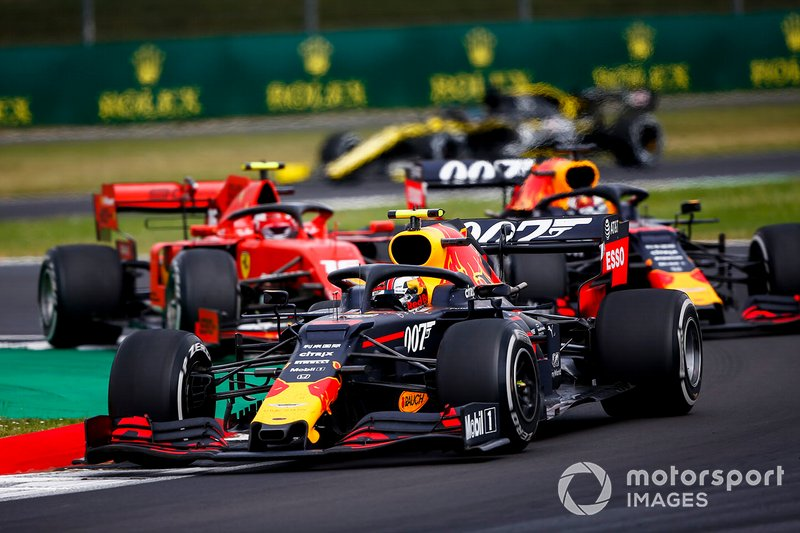 Pierre Gasly, Red Bull Racing RB15, leads Max Verstappen, Red Bull Racing RB15, and Charles Leclerc, Ferrari SF90