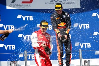 Race winner Juri Vips, Hitech Grand Prix, Marcus Armstrong, PREMA Racing spray champagne on the podium