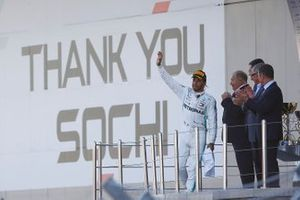 Race winner Lewis Hamilton, Mercedes AMG F1 throws his trophy in the air on the podium