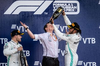 Valtteri Bottas, Mercedes AMG F1, 2nd position, and Lewis Hamilton, Mercedes AMG F1, 1st position, celebrate with Fred Judd, Chief Engineer Trackside, Mercedes AMG F1, on the podium