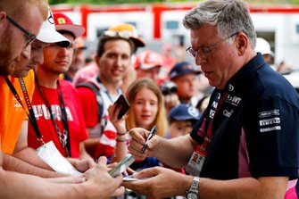 Otmar Szafnauer, Team Principal and CEO, Racing Point, signs autographs for fans