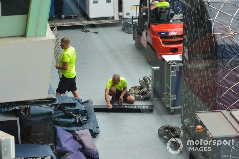 Red Bull Honda team members unpack freight