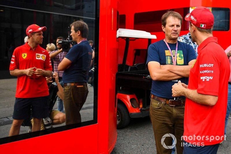 Sebastian Vettel, Ferrari, talks to journalist Michael Schmidt