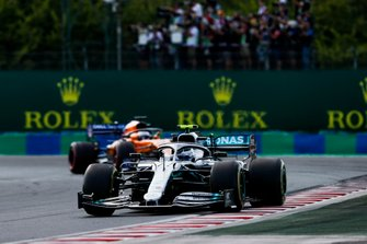 Valtteri Bottas, Mercedes AMG W10, leads Carlos Sainz Jr., McLaren MCL34