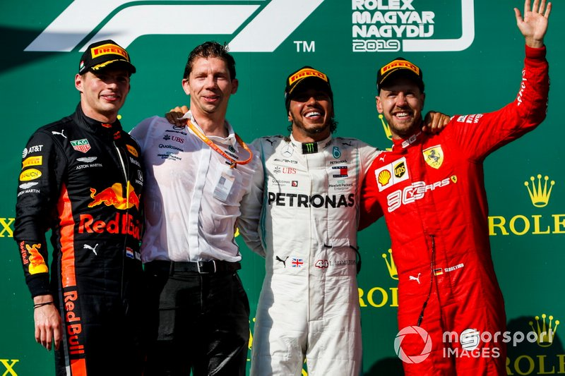 Max Verstappen, Red Bull Racing, 2nd position, Matt Deane, Chief Mechanic, Mercedes AMG, Lewis Hamilton, Mercedes AMG F1, 1st position, and Sebastian Vettel, Ferrari, 3rd position, on the podium