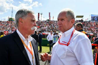 Chase Carey, Chairman, Formula 1, and Helmut Marko, Consultant, Red Bull Racing