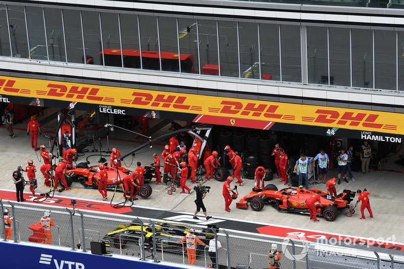 Sebastian Vettel, Ferrari SF90, and Charles Leclerc, Ferrari SF90, in the pits during practice
