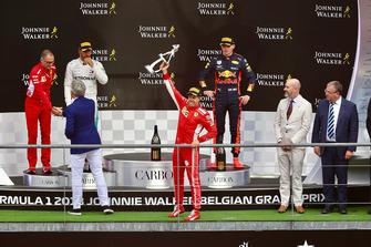 Sebastian Vettel, Ferrari celebrates with his trophy on the podium with: David Sanchez, Ferrari, Lewis Hamilton, Mercedes AMG F1, Max Verstappen, Red Bull Racing