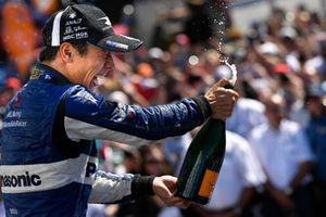 Takuma Sato, Rahal Letterman Lanigan Racing Honda celebrates the win with champagne on the podium