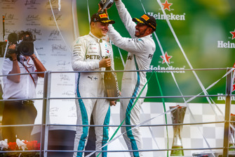 Lewis Hamilton, Mercedes AMG F1, first position, pours Champagne on the head of Valtteri Bottas, Mercedes AMG F1, third position, on the podium