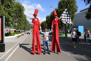 Stilt walkers with fans