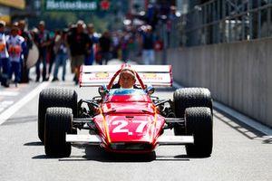 Belgian racing legend Jacky Ickx demonstrates a Ferrari 312B